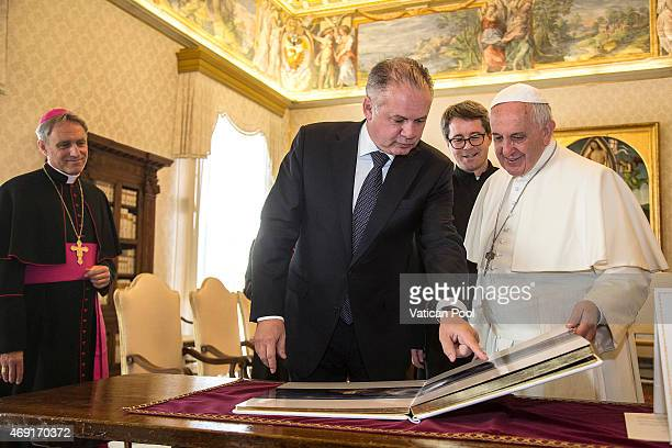 Pope Francis exchanges gifts with President of Slovakia Andrej Kiska during a private audience at the Apostolic Palace on April 9 2015 in Vatican...