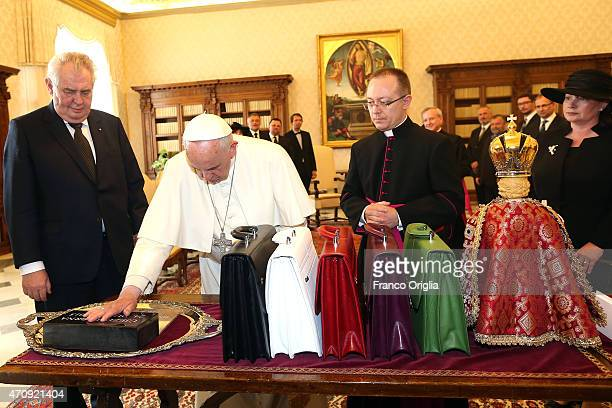 Pope Francis exchanges gifts with President of the Czech Republic Milos Zeman and his wife Ivana during an audience at the Apostolic Palace on April...