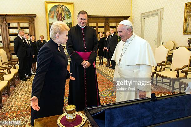 Pope Francis exchanges gifts with president of the Republic of Lithuania Ms Dalia Grybauskaite during a private audience at the Apostolic Palace on...