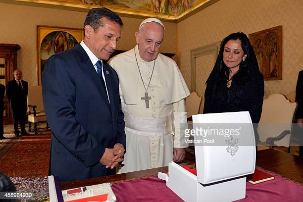 Pope Francis exchanges gifts with President of the Republic of Peru Ollanta Moises Humala Tasso and wife Nadine Heredia Alarcon during an audience at...