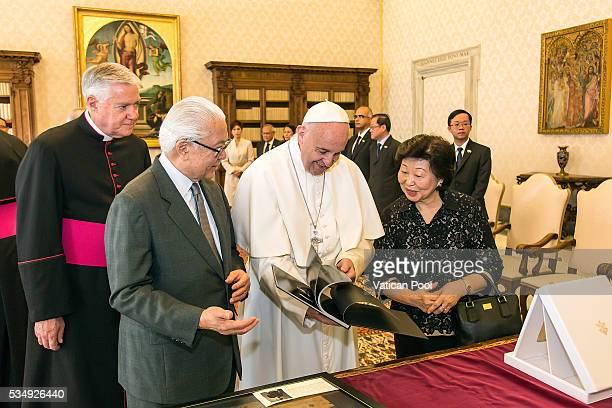 Pope Francis exchanges gifts with President of the Republic of Singapore Tony Tan Keng Yam during an audience at the Apostolic Palace on May 28, 2016...
