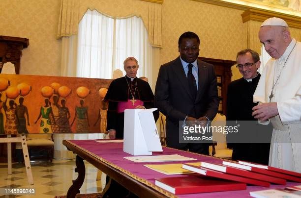 Pope Francis exchanges gifts with President of Togo Faure Essozimna Gnassingbe during an audience at the Apostolic Palace on April 29 2019 in Vatican...