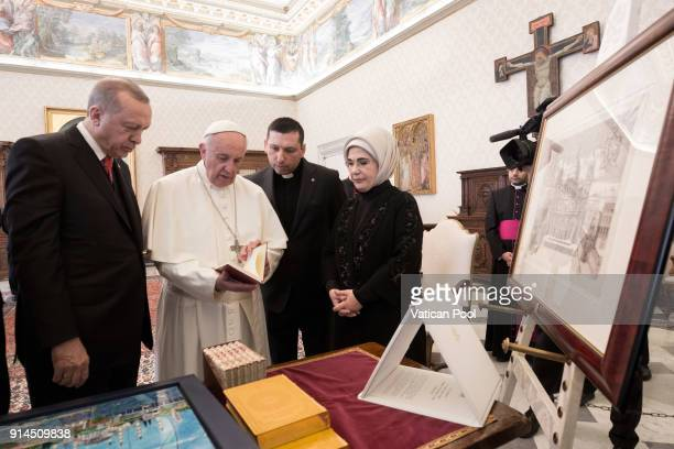 Pope Francis exchanges gifts with President of Turkey Recep Tayyip Erdogan and wife Ermine Erdogan during an audience at the Apostolic Palace on...