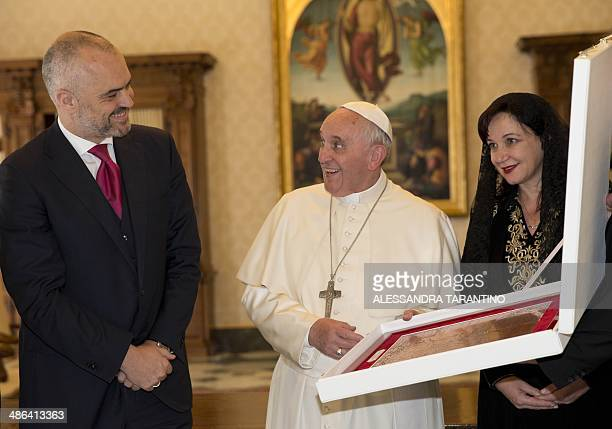 Pope Francis exchanges gifts with Prime Minister of Albania, Edi Rama and his wife Linda, during a private audience at the Vatican, on April 24,...