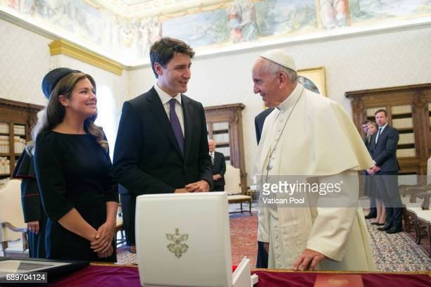 Pope Francis exchanges gifts with Prime Minister of Canada Justin Trudeau and his wife Sophie Gregoire during an audience at the Apostolic Palace on...