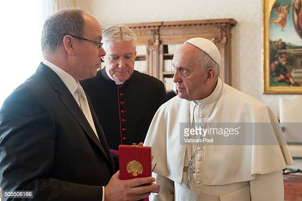 Pope Francis exchanges gifts with Prince Albert II of Monaco at the Apostolic Palace on January 18 2016 in Vatican City Vatican