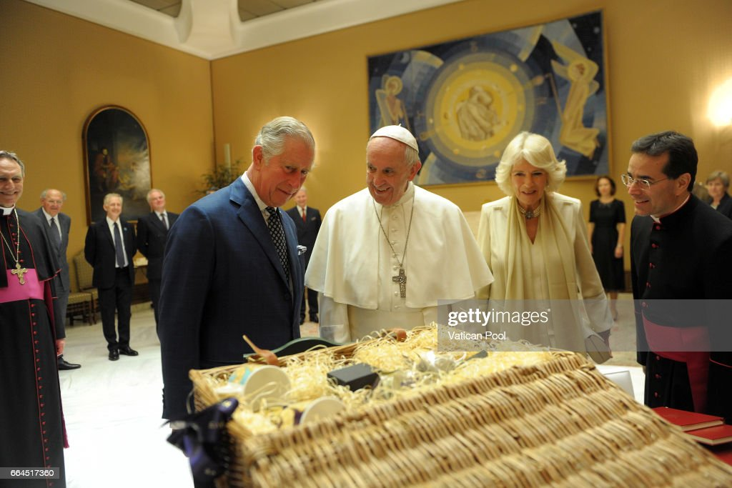 Pope Francis exchanges gifts with Prince Charles, Prince of Wales and Camilla, Duchess of Cornwall during an audience on April 4, 2017 in Vatican City, Vatican. Prince of Wales and Duchess of Cornwall are in Italy for a six day visit.