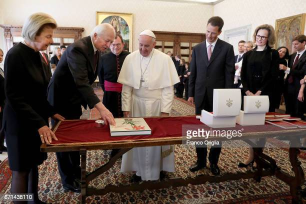 Pope Francis exchanges gifts with Prince HansAdam of Liechtenstein his wife Princess Marie and Hereditary Prince Alois of Liechtenstein and his wife...