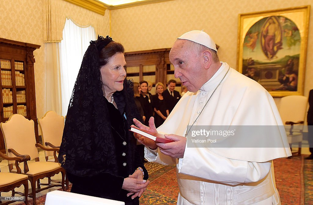 Pope Francis exchanges gifts with Queen Silvia of Sweden during a private audience at the Apostolic Palace on April 27, 2015 in Vatican City, Vatican. In the afternoon the Queen will attend a meeting on the theme of human trafficking at the Vatican.
