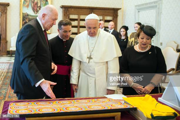 Pope Francis exchanges gifts with the GovernorGeneral of the Commonwealth of Australia Peter Cosgrove and his wife Lady Lynne Cosgrove during an...
