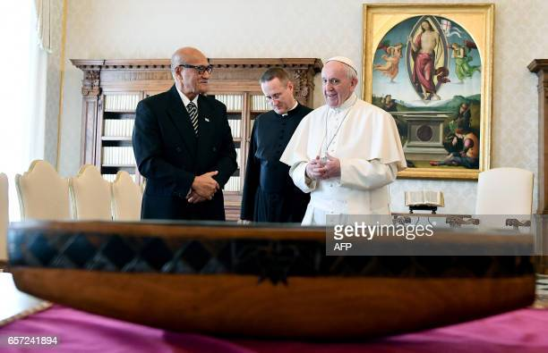 Pope Francis exchanges gifts with the President of the Republic of Fiji Jioji Konousi Konrote during a private audience on March 24 2017 at the...