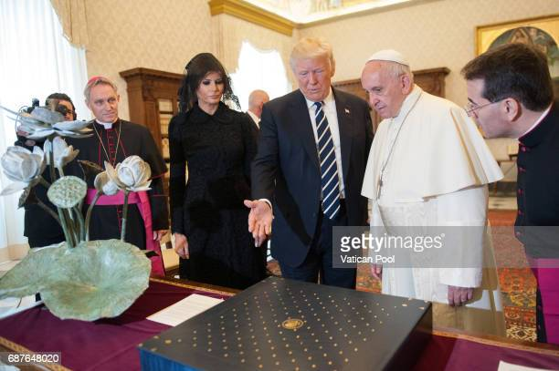 Pope Francis exchanges gifts with United States President Donald Trump and First Lady Melania Trump during an audience at the Apostolic Palace on May...