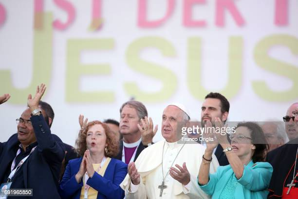 Pope Francis, flanked by Evangelical leaders Patti Mansfield and Michelle Moran , attends The Golden Jubilee of the Catholic Charismatic Reneval at...