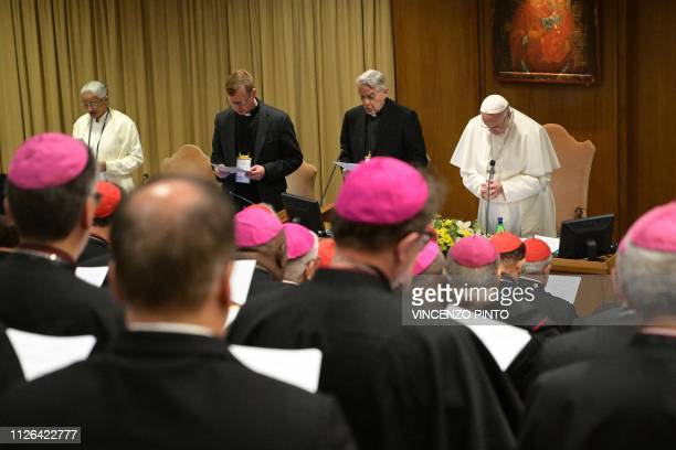 Pope Francis flanked by Italian priest Federico Lombardi prays during the opening of a global child protection summit for reflections on the sex...