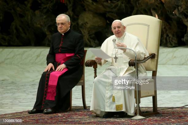 Pope Francis flanked by monsignor Leonardo Sapienza holds his homily during his weekly audience at the Paul VI Hall on February 12 2020 in Vatican...