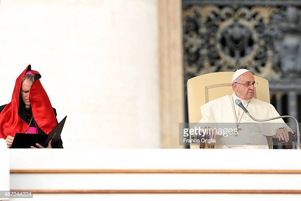 Pope Francis flanked by Prefect of the Pontifical House and former personal secretary of Pope Benedict XVI Georg Ganswein attends his weekly audience...