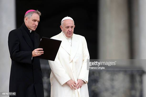 Pope Francis, flanked by Prefect of the Pontifical House Georg Ganswein , holds his weekly audience at The Vatican on November 18, 2015 in Vatican...