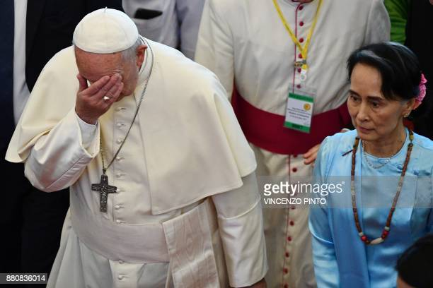 Pope Francis gestures beside Myanmar's civilian leader Aung San Suu Kyi in Naypyidaw on November 28 2017 Pope Francis held talks with Myanmar's...