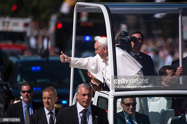 Pope Francis gives a thumbs up to people during a parade near the Ellipse on his first visit to the United States in Washington DC on Wednesday...