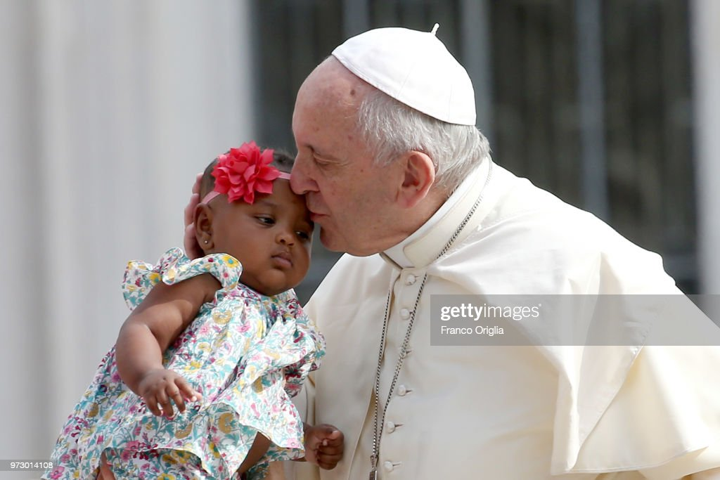 Pope Francis greets a baby during the general audience in St. Peter's Square on June 13, 2018 in Vatican City, Vatican. Pope Francis looked ahead to a month of top class football during his General Audience expressing his hope the FIFA World Cup Russia will favour solidarity and peace among nations.