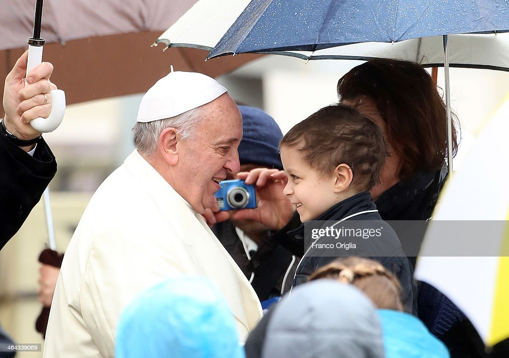 Pope Francis greets a child during his weekly General Audience in St. Peter's Square on January 22, 2014 in Vatican City, Vatican. Pope Francis devoted the catechetical portion of his weekly General Audience to the Week of Prayer for Christian Unity. The main reflection delivered by Pope Francis in Italian, said, 'We know that Christ has not been divided; yet we must sincerely recognize that our communities continue to experience divisions which are a source of scandal and weaken our witness to the Gospel.'