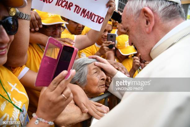 Pope Francis greets an elderly woman at Plaza de Armas square in the Peruvian city of Trujillo on January 20 2018 Pope Francis headed to Trujillo and...
