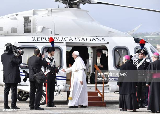 Pope Francis greets an Italian guard before to board the helicopter to San Giovanni Rotondo on March 17 2018 during his pastoral visit in Pietrelcina...