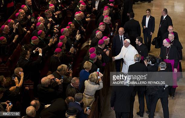 Pope Francis greets Bishops after speaking at St Charles Borromeo Seminary in Wynnewood Pennsylvania on September 27 2015 AFP PHOTO/ ANDREW...