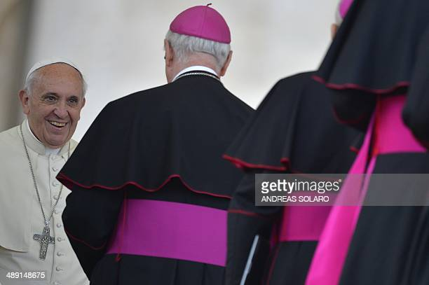 Pope Francis greets bishops at the end of an audience with Catholic schools at St Peter's square on May 10 2014 at the Vatican AFP PHOTO / ANDREAS...