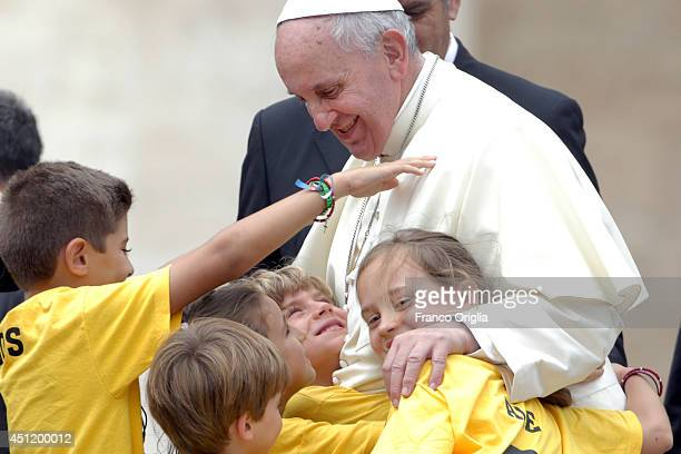 Pope Francis greets children of Madrid diocese during his weekly general audience in St Peter's Square on June 25 2014 in Vatican City Vatican This...