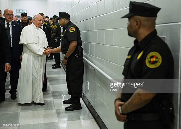 Pope Francis greets corrections officers during a visit to the CurranFromhold Correction Facility September 27 015 in in Philadelphia Pennsylvania...