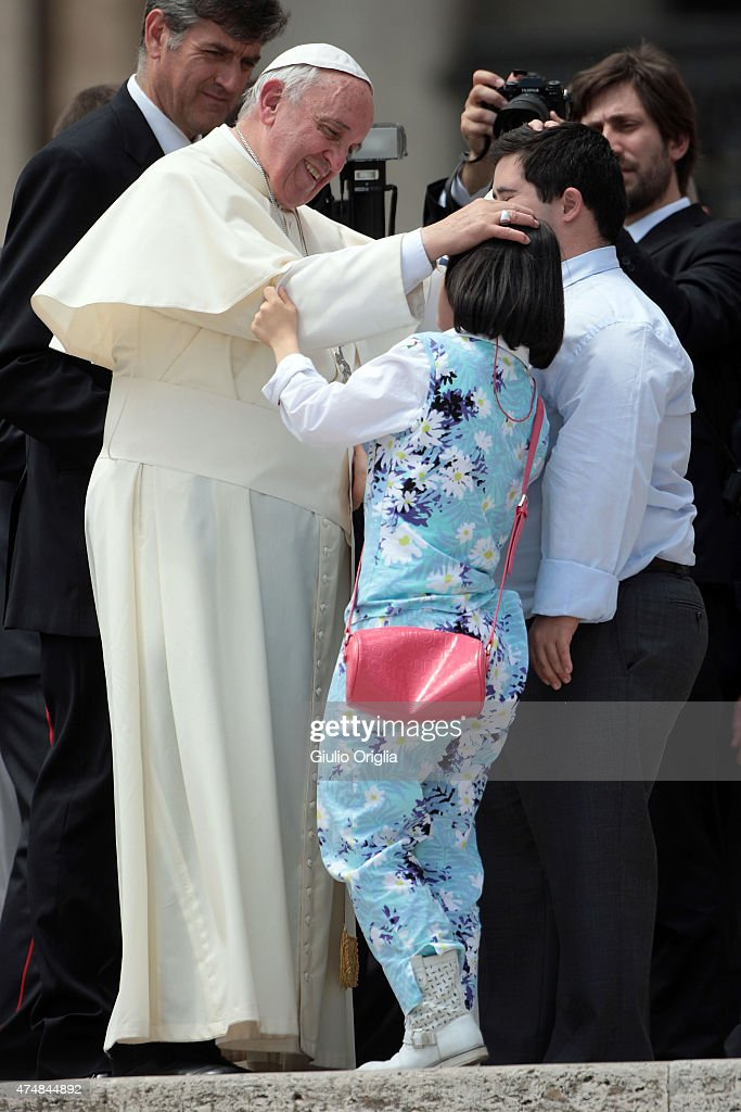 Pope Francis greets disabled children as he holds his weekly audience in St. Peter's Square on May 27, 2015 in Vatican City, Vatican. During his speech the Pontiff spoke to couples who are engaged to be married and told them not to be superficial as they prepare to enter into a life-long covenant of love.
