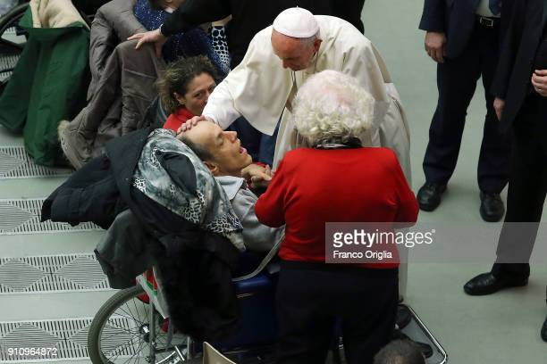 Pope Francis greets disabled people during an audience with members of Italian Red Cross at the Paul VI Hall on January 27 2018 in Vatican City...