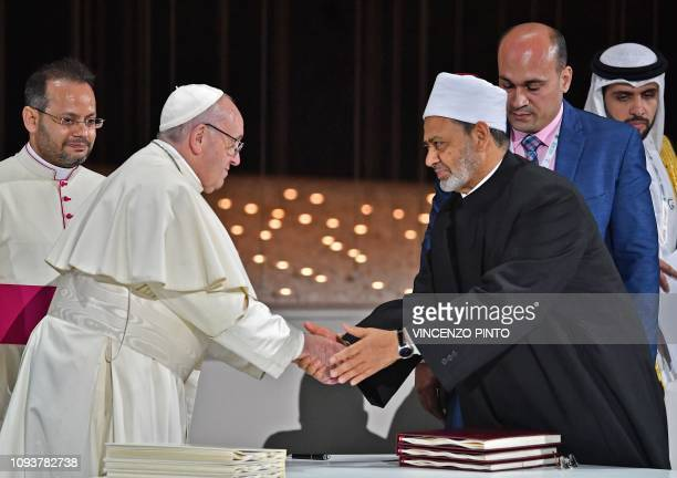 Pope Francis greets Egypt's Azhar Grand Imam Sheikh Ahmed alTayeb after signing on documents during the Human Fraternity Meeting at the Founders...