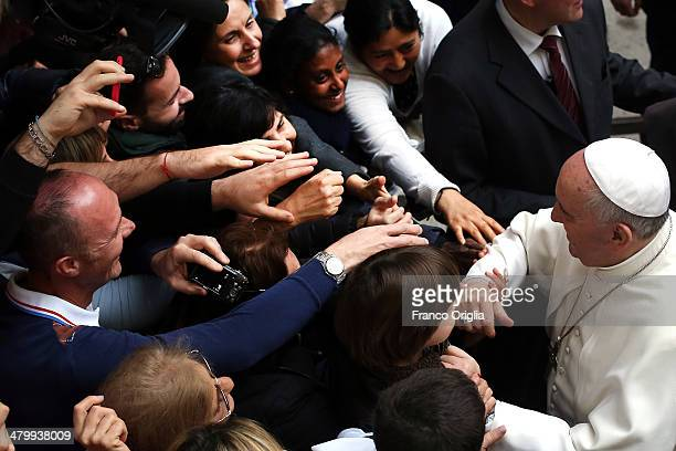 Pope Francis greets faithful as he arrives at St Gregory VII Church for prayer vigil with relatives of the Mafia's victims organized by the Libera...