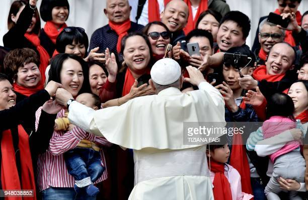 TOPSHOT Pope Francis greets faithful from China as he arrives for his weekly general audience on April 18 on St Peter's square in the Vatican / AFP...