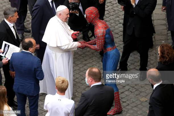 Pope Francis greets Mattia Villardita, a young man in the Spider-Man costume who makes children smile in the pediatric wards of hospitals, during his...