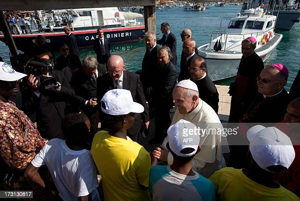 Pope Francis greets migrants during his visit to the island of Lampedusa a key destination of tens of thousands of wouldbe immigrants from Africa...