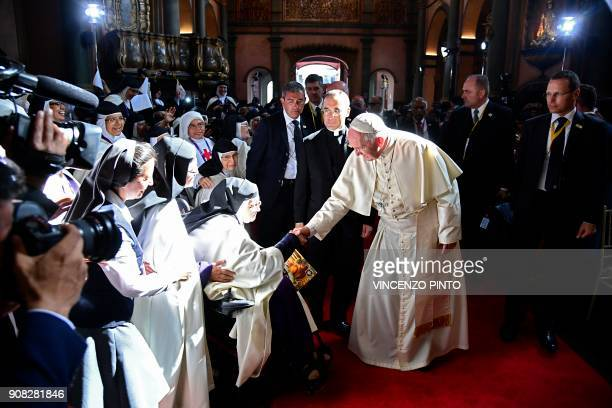 Pope Francis greets nuns as he arrives at the Senor de los Milagros Sanctuary in Lima on January 21 2018 Pope Francis urged Latin America's faithful...