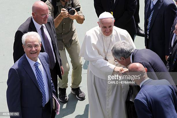 Pope Francis greets people as he arrives at the Evangelical Church of Reconciliation in Caserta Italy on July 28 2014 Pope Francis is in Caserta for...