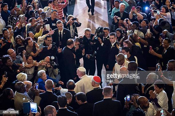 Pope Francis greets people as he arrives to pray and visit St Patrick's Church on September 24 2015 in Washington DC Pope Francis is on a fiveday...