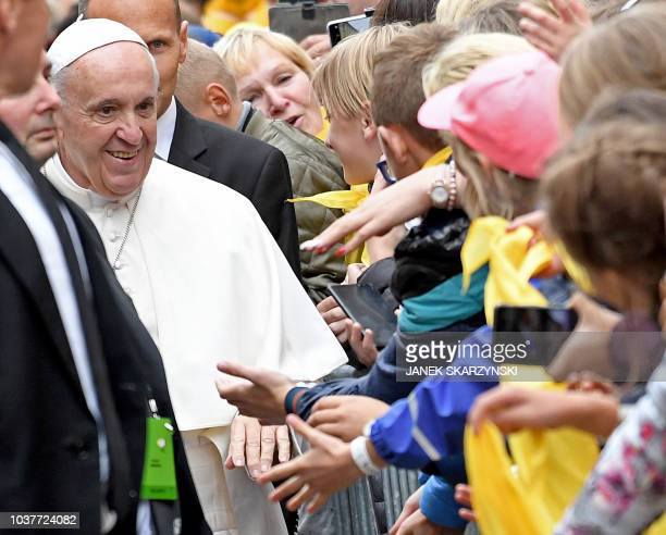 Pope Francis greets people on his way to the Mather Misericordiae Shrine in Vilnius during a welcoming ceremony on September 22 2018 Pope Francis...