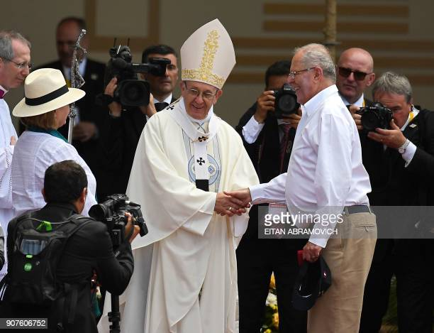 Pope Francis greets Peruvian President Pedro Pablo Kuczynski at an openair mass at the beach resort town of Huanchaco northwest of the Peruvian city...