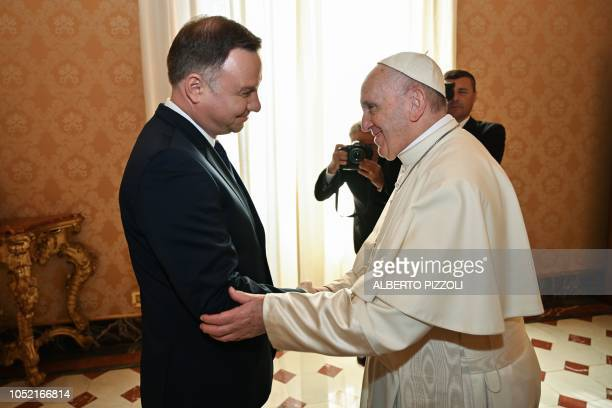 Pope Francis greets Poland's President Andrzej Duda upon his arrival for a private audience at the Vatican on October 15 2018