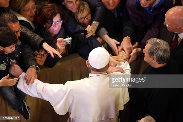 Pope Francis greets relatives of the Mafia's victims as he arrives at St Gregory VII Church for prayer vigil organized by the Libera Foundation on...