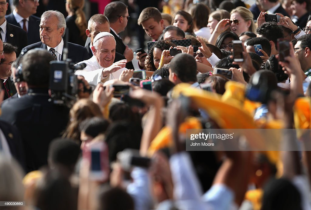 Pope Francis greets school children upon his arrival to the Lady Queen of Angels school on September 25, 2015 in the Harlem neighborhood of New York City. The Pope visited the inner city Catholic school in east Harlem and met with children, immigrants and Catholic Charities workers on the second day of his visit to New York City.