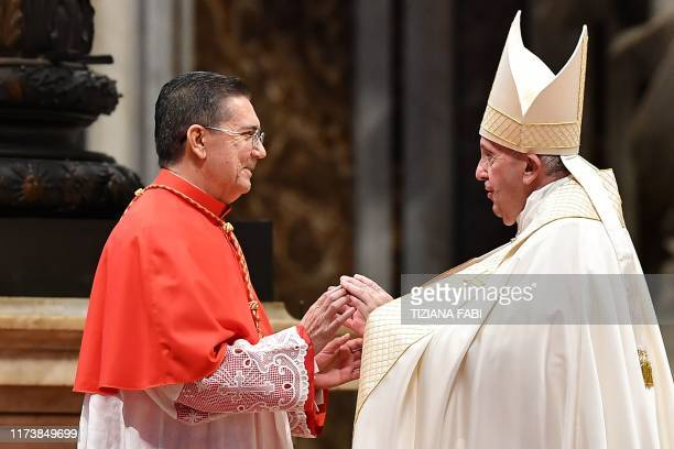 Pope Francis greets Spanish prelate Miguel Angel Ayuso Guixot prior to appointing him Cardinal during an Ordinary Public Consistory for the creation...