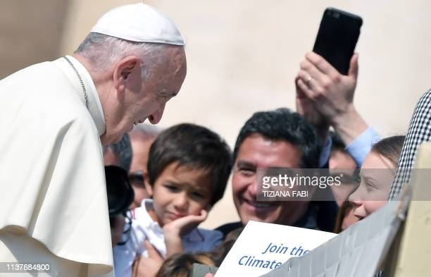 Pope Francis greets Swedish teenage environmental activist Greta Thunberg during a weekly general audience at Saint Peter's square on April 17 2019