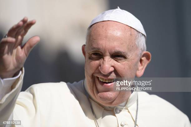 Pope Francis greets the crowd as he arrives for his general audience at St Peter's square on June 10 2015 at the Vatican AFP PHOTO / FILIPPO...