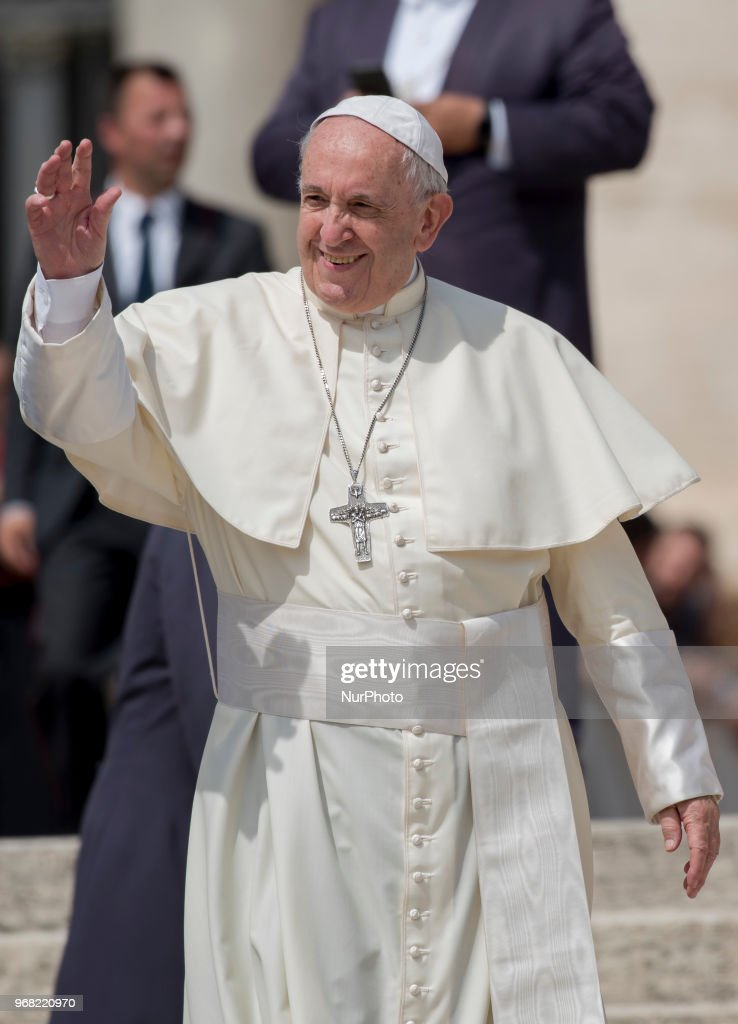 Pope Francis greets the crowd as he leaves Vatican for his weekly general audience in St. Peter's Square at the Vatican, Wednesday, June 6, 2018.